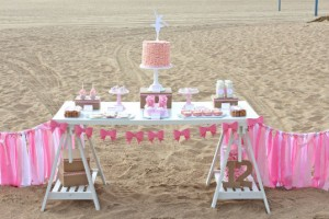 birthday-party-ideas-audreys-favorite-things-beach-ocean-dessert-table-with-ribbon-garland