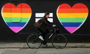 A woman cycles past a marriage equality mural in the Liberties area of Dublin, as Ireland should become the international advocate for gay rights, a key figure in spearheading the country's vote for same-sex marriage has said.. Picture date: Sunday May 24, 2015. On the back of the resounding yes for gay marriage - 1.2 million Irish voters backed it - attention is now turning to when the first ceremonies will take place. See PA story IRISH GayMarriage. Photo credit should read: Brian Lawless/PA Wire