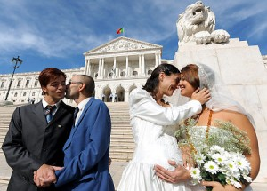 "Gay rights activists ""Jose"" (L) and ""manuel"" (2ndL) and ""Ana"" (2ndR) and ""Maria"" (R) stage a wedding ceremony in front of the Portuguese parliament in downtown Lisbon on October 10, 2008. Left-wing parties Bloco de Esquerda and Os Verdes failled today to pass a bill proposing to legalize gay marriage. AFP PHOTO / FRANCISCO LEONG (Photo credit should read FRANCISCO LEONG/AFP/Getty Images) Original Filename: Par2206745.jpg"