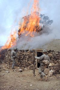 U.S. Army Soldiers from Charlie Company, 2nd Battalion, 87th Infantry Regiment burn down a Taliban safehouse discovered during operations in the Paktika province of Afghanistan March 30, 2007. (U.S. Army photo by Staff Sgt. Justin Holley) (Released)