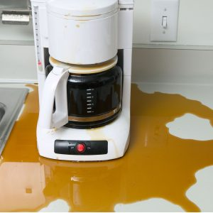 AY8E82 Coffee maker leaking coffee in office kitchen