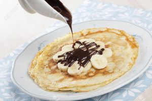 8571927-Crepes-with-banana-and-chocolate-sauce-Stock-Photo-crepe