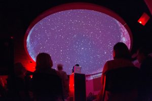 Visitors view an astronomy show in the planetarium of the Robert McCullough Science Center at Observatory Park in Montville, Ohio on Friday, May 25, 2012. Due to rain and thunderstorms visitors to the park were unable to view the stars through telescopes, instead opting to view an astronomy show in the planetarium. (Photo For The Dispatch by Scott R. Galvin)