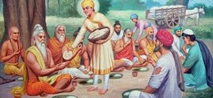 Young Guru Nanak serving holy men