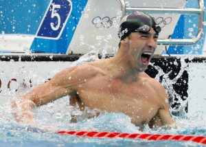FILE - In this Aug. 16, 2008 file photo, United States' Michael Phelps reacts as he wins gold in the final of the men's 100-meter freestyle during the swimming competitions in the National Aquatics Center at the Beijing 2008 Olympics in Beijing. Phelps retires with twice as many golds as any other Olympian, and his total of 22 medals is easily the best mark. (AP Photo/Mark Baker, File)
