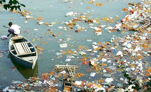 Yamuna River in New Delhi, India. (Pollution, environmental, Scavengers at work in the Yamuna at Qudesia Ghat, Boat, Garbage)