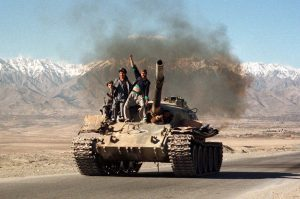 Taleban militiamen chant slogans as they drive a tank to the capital Kabul on November 9, from the front line only 20 km (12 miles) away. The Taleban are in a standoff with opposition forces led by Commander Ahmad Shah Masood. PAKISTAN - RTR8JIB